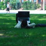 Guy laying on grass, using laptop. URL: https://www.flickr.com/photos/49889874@N05/4768870493/