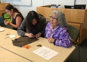Elizabeth Fleagle, right, leads a beading workshop as one of UW's Elders in residence.