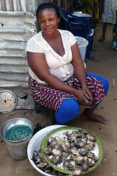 An oyster trader in Nigeria.