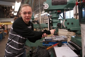 Sylvie Troxel, mechanical co-lead for UW's EcoCAR 3 team, working in the machine shop.