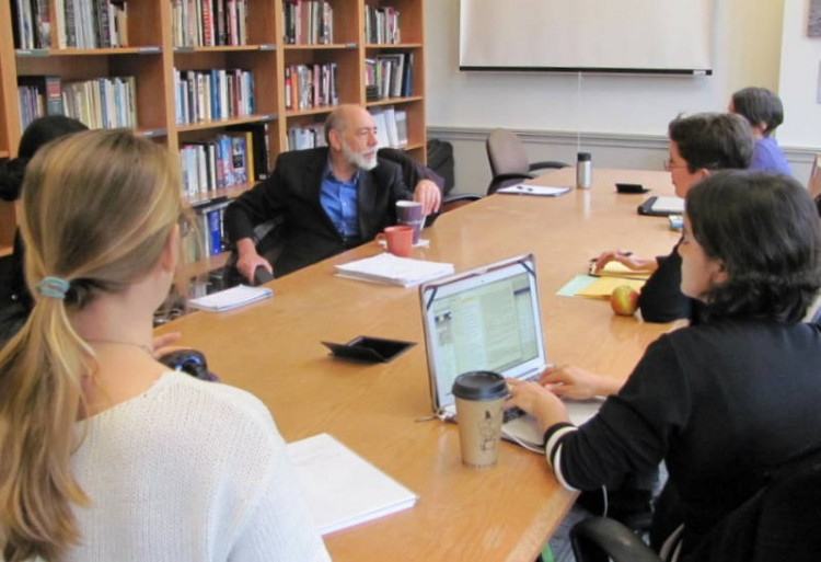 Students participate in a discussion with Sanford Schram, a professor at New York's Hunter College, after his lecture on campus in April 2014.