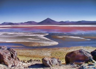 Laguna Colorada is a shallow salt lake in the southwest of Bolivia. One of several places on Earth whose colors are dominated by nonphotosynthetic pigments. Eddie Schwieterman of the University of Washington has research on how such nonphotosynthetic biosignatures might appear on exoplanets, or those outside our solar system.