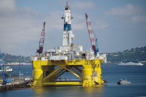 yellow oil rig with Seattle in background