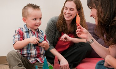 A toddler takes part in early intervention activities at the UW Autism Center.