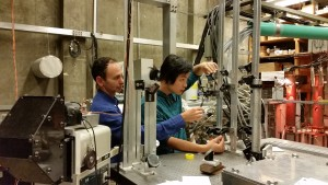 UW Aeronautics and Astronautics professor Uri Shumlak and student Bonghan Kim work on an earlier prototype of the Z-pinch device.