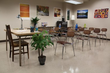 A non-stereotypical computer science classroom decorated with plants and nature posters.
