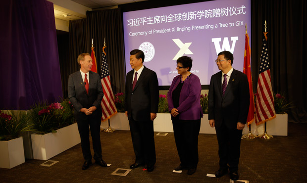 Microsoft President Brad Smith, Chinese President Xi Jinping, UW Interim President Ana Mari Cauce and Tsinghua President Qiu Yong at the presentation of a dawn redwood tree to the Global Innovation Exchange by President Xi.