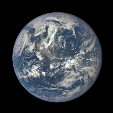 "The Earth as seen by the Polychromatic Imaging Camera aboard NASA's Deep Space Climate Observatory satellite, July 2015. Recent research by UW grad student Edward Schwieterman shows that observations of nitrogen in Earth's atmosphere from afar might help astronomers detect the ""invisible"" gas in the atmospheres of planets beyond our solar system."