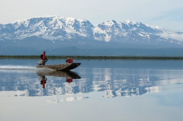 University of Washington researchers pass in front of volcano Mt. Veniaminof while traversing Black Lake on their way to the Alec River.