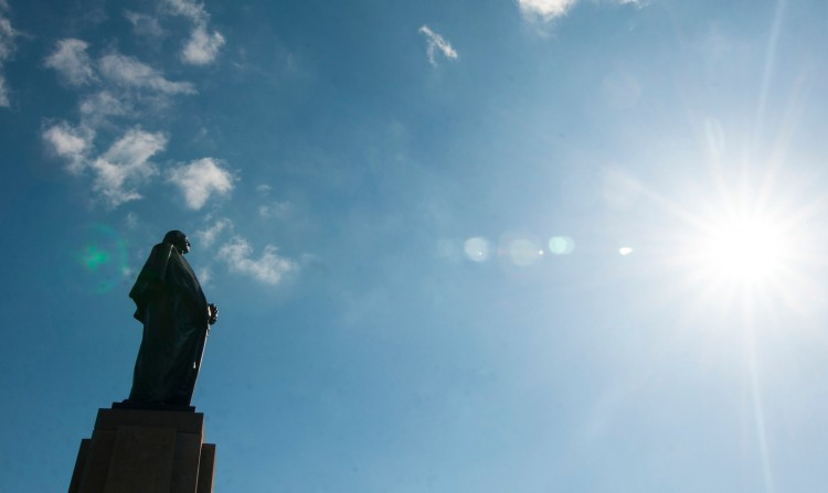 A sunny day at the University of Washington Seattle campus, silhouette of George Washington statue.