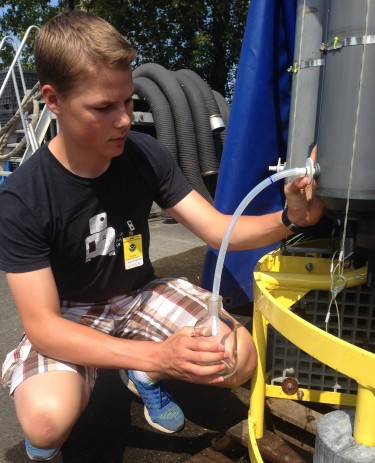 University Prep student Jacob Richey fills a sample bottle during a training session.