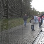Visitors touch names and leave gifts at the Vietnam War Memorial in Washington, D.C., in 2006.