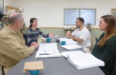Students in the mixed-enrollment course work together on a class assignment. Clockwise, from left, inmate William Joice, UW student Talia Balma, inmate Noel Caldellis and UW student Becky Womelsdorf.