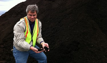 Chuck Rice, a Kansas State University professor, with a finished pile of food and yard waste compost.