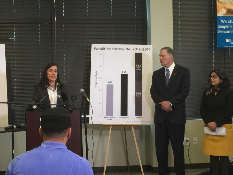 Jennifer Stuber, co-founder of Forefront: Innovations in Suicide Prevention, speaks while Gov. Jay Inslee and Monica Vavilala, director of the Harborview Injury Prevention and Research Center, look on.