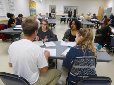 Inmate Arthur Longworth, left, talks with UW students (from left) Kathryn Joy, Meron Fikru and Emily Krueger.