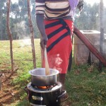 Photo of woman testing stove in Kenya