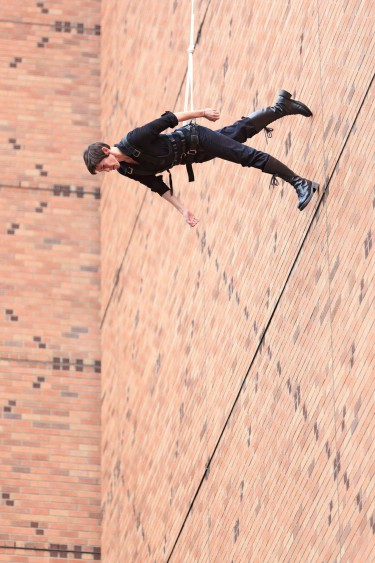 "Rachael Lincoln was assisted in performing ""Man Walking Down the Side of a Building"" by Derrick Lindsay, who worked the ropes."
