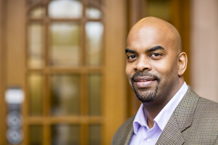 Joe Lott, a UW associate professor of education, is spearheading the university's new Brotherhood Initiative