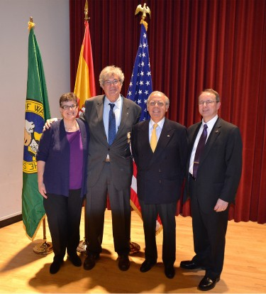 Anthony Geist, UW professor of Spanish and Portuguese studies, is honored with a knighthood by the Kingdom of Spain April 16 in Brechemin Auditorium. From left, UW President Ana Mari Cauce; Geist; Luis Fernando Esteban, Spain's honorary consul in Washington state; and UW Dean of Arts & Sciences Robert Stacey.