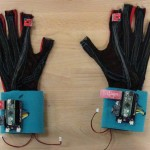 """These """"SignAloud"""" gloves developed by UW students contain sensors that record hand position and movement and transmit data wirelessly to a central computer, which uses algorithms to recognize and translate sign language gestures."""