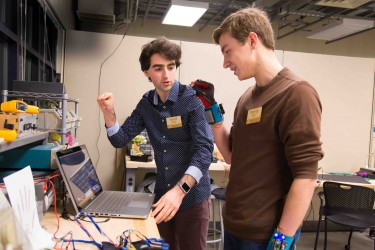Navid Azodi (left) and Thomas Pryor (right) refine their SignAloud system in the UW CoMotion MakerSpace, where they developed the award-winning technology.