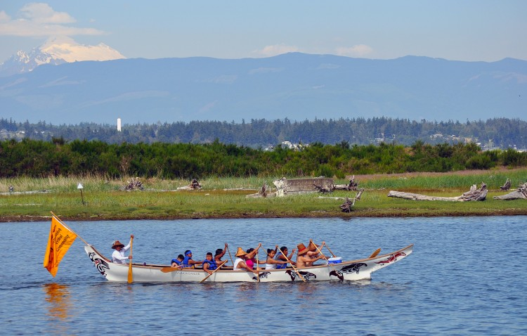 The Salmon Dancer Canoe Family paddles along the shorelines of Swinomish.