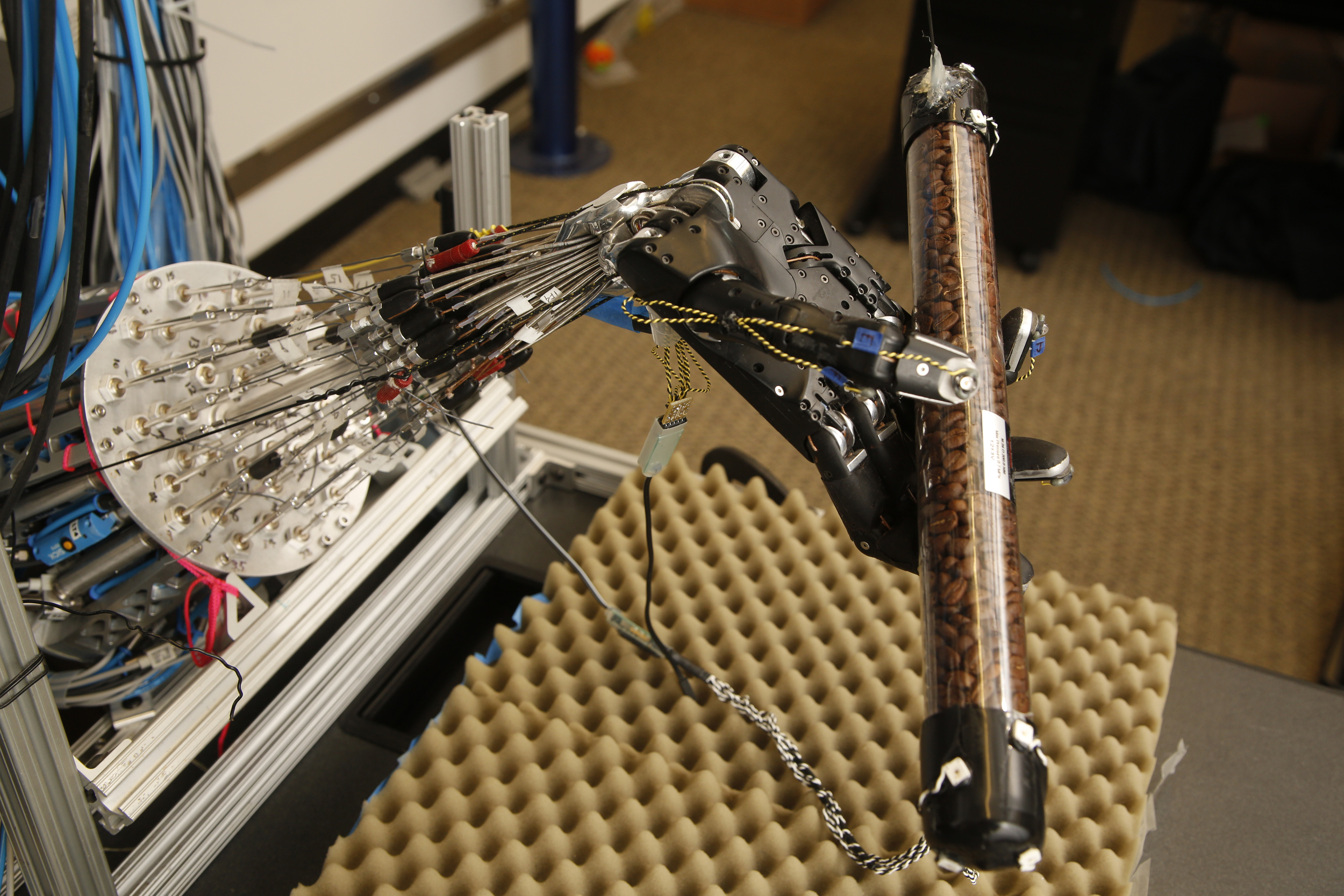 This five-fingered robot hand learns to get a grip on its