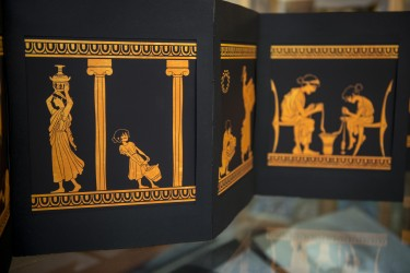 "A page from the artist book ""A Woman's Work,"" created by former student Emma Schulte with Kathryn Topper, UW associate professor of classics. The book explores what Greek faces would look like if they showed the work Greek women actually did."
