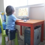 picture of child using computer