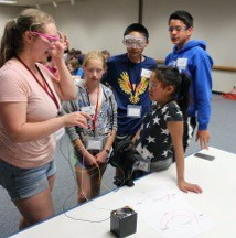 UW undergraduate student Hannah McConnaughey works with students during camp.