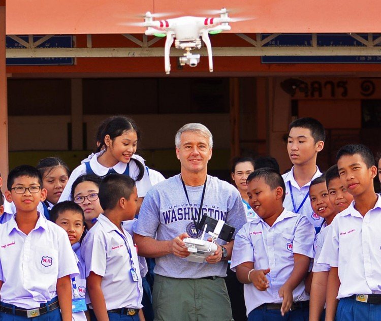 Randy Kyes with students at an outreach program in Thailand.