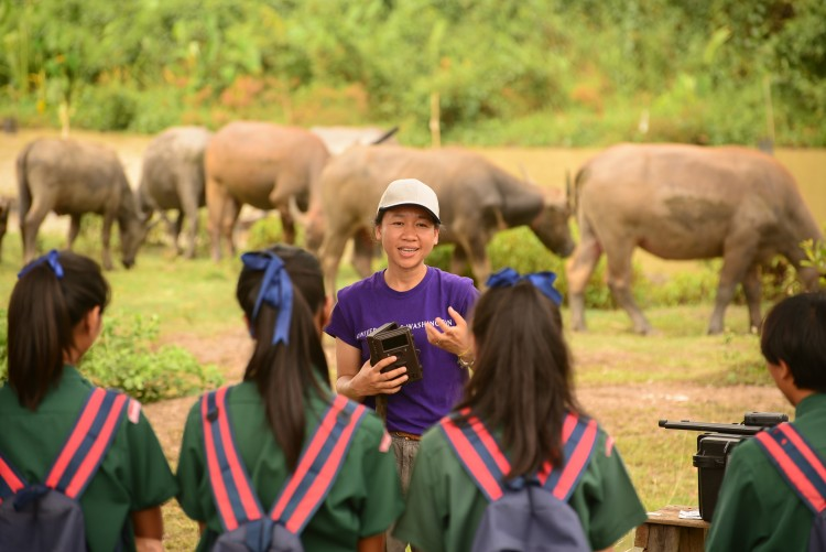 "Pensri ""Elle"" Kyes, Randy Kyes' collaborator and wife, with students during an educational outreach program in Thailand."