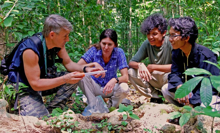 Randy Kyes, left, with UW and Indonesian students on Tinjil Island, Indonesia.