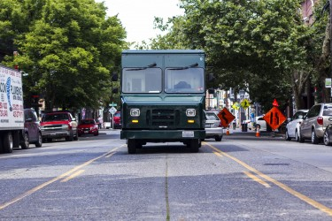 In dense commercial neighborhoods with limited parking, large truck drivers may resort to parking in the center lane while they make deliveries