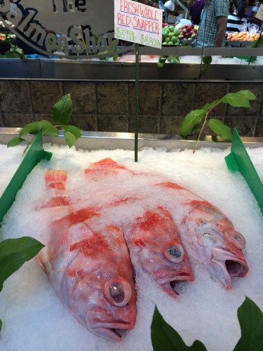 Fish labeled red snapper seen on ice in a fish market.