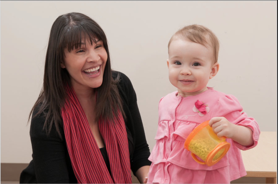 Research scientist Tanya St. John works with a baby at the University of Washington Autism Center.