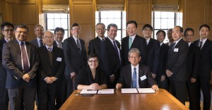 UW President Ana Mari Cauce and Tohoku University President Susumu Satomi (both seated) at the signing ceremony, with officials from the UW and Tohoku University, as well as representatives of the Japanese government