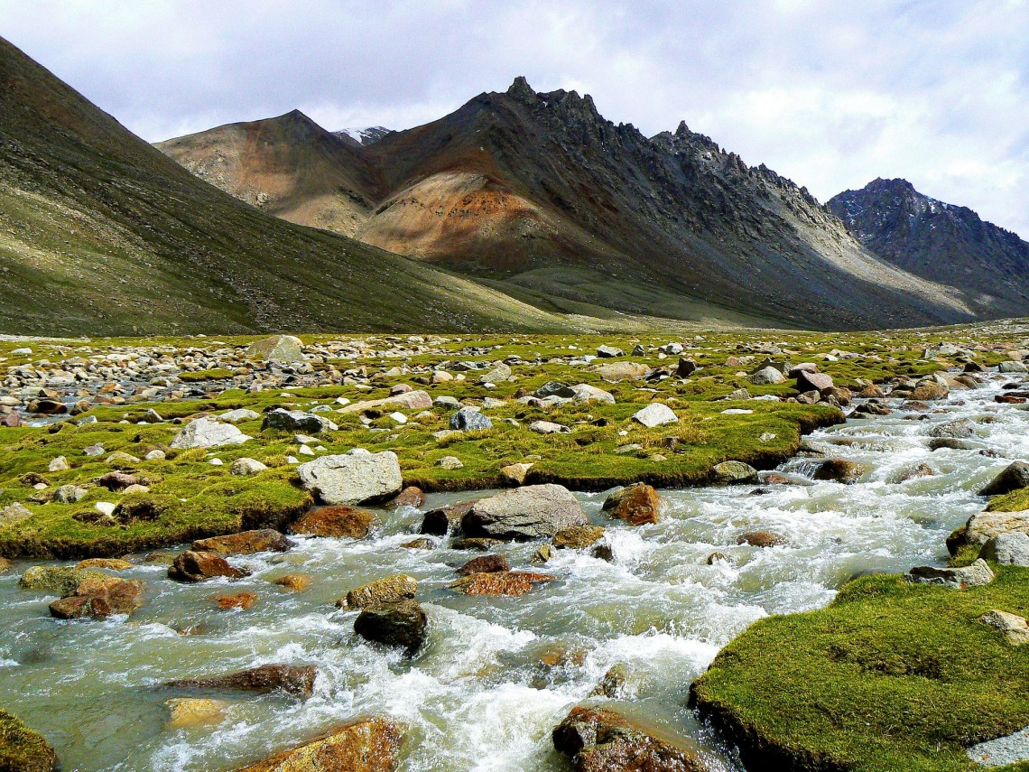 river flowing through mountain valley