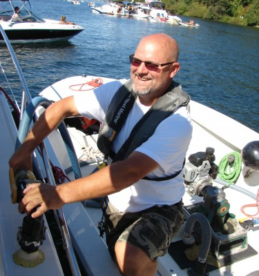 Terry Durfee pumps out a bilge on Lake Washington.