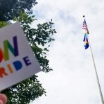 """UW Pride"" sticker with flagpole in background"