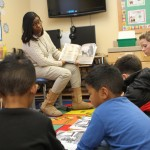 A new study by the University of Washington suggests schools need to partner with parents, rather than offer them limited volunteer roles. In this photo, parent volunteers read to a class of students.