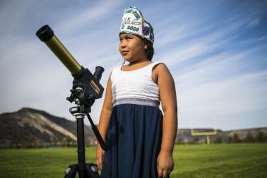 Looking through a telescope.