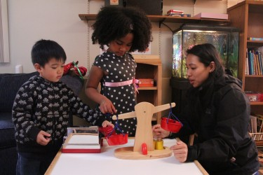Children work with a teacher at an early learning facility that partners with Cultivate Learning (formerly the UW Childcare Quality & Early Learning Center for Research and Professional Development).