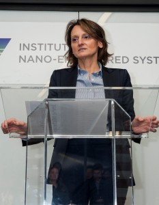 A woman speaking at a podium.