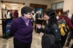 UW President Ana Mari Cauce speaking with Miqin Zhang, a UW professor of materials science and engineering, at the launch of NW IMPACT on Jan. 31.