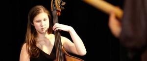 Jazz Studies major Carmen Rothwell, bass, in performance at the 2013 Improvised Music Project Festival