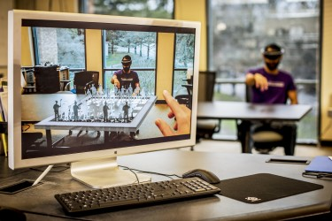 The UW Reality Lab will focus on developing next-generation virtual and augmented reality technologies and educating an industry workforce. In this holographic chess game developed by UW students, opponents move pieces that can only be seen through a virtual reality headset.