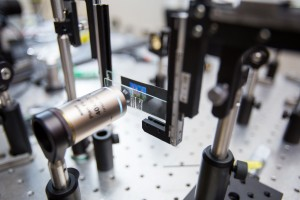 A portion of the team's experimental setup for capturing an image using a metalens. The researchers capture an image of flowers through a metalens (mounted on a microscope slide) and visualize it through a microscope.