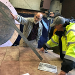 Woody Sullivan, UW professor emeritus of astronomy, consults with Larry Tate, principal at Seattle's Fabrication Specialties Ltd., right, on the necessary angle and placement of a new gnomon to ensure the time-keeping accuracy of Olympia's Territorial Sundial.